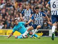 Brighton & Hove Albion's Steven Alzate (right)  is tackled by Tottenham Hotspur's Erik Lamela (left) <br /> <br /> Photographer David Horton/CameraSport<br /> <br /> The Premier League - Brighton and Hove Albion v Tottenham Hotspur - Saturday 5th October 2019 - The Amex Stadium - Brighton<br /> <br /> World Copyright © 2019 CameraSport. All rights reserved. 43 Linden Ave. Countesthorpe. Leicester. England. LE8 5PG - Tel: +44 (0) 116 277 4147 - admin@camerasport.com - www.camerasport.com