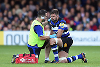 Elliott Stooke of Bath Rugby is treated for a knock by Declan Lynch. Aviva Premiership match, between Bath Rugby and Saracens on September 9, 2017 at the Recreation Ground in Bath, England. Photo by: Patrick Khachfe / Onside Images
