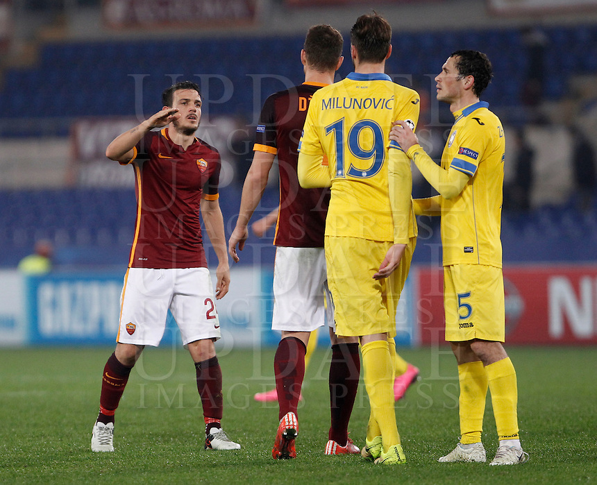 Calcio, Champions League: Gruppo E - Roma vs Bate Borisov. Roma, stadio Olimpico, 9 dicembre 2015.<br /> Roma's Alessandro Florenzi, left, greets his teammate Edin Dzeko, past Bate Borisov's Nemanja Milunovic, second from right, and Maksim Zhavnerchik, right, at the end of the Champions League Group E football match between Roma and Bate Borisov at Rome's Olympic stadium, 9 December 2015. Roma drawed 0-0 against Bate to join the round of 16 with a mere six points.<br /> UPDATE IMAGES PRESS/Isabella Bonotto