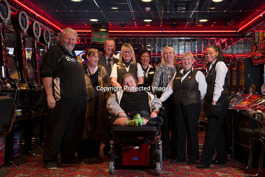 "20/11/15<br /> <br /> L/R: Alan Kent, Diane Kent, Simon Gudgeon,  Helen Stockdale, Arron Kent, Lorna Cord, Wanda Kidd, Janet Neal and Gemma Wylie.<br /> <br /> Thanks to the joint fundraising efforts of customers and staff at Cashino adult gaming centre on Station Street Burton-On-Trent, Arron Kent, a seventeen year old teenager from Swadlincote has received a new, customised powered wheelchair to help boost his mobility. <br /> <br /> Arron, who lives with his mum, Diane, dad Alan and sister Tabitha, suffers from Osteogenesis Imperfecta – a severe brittle bone disease which has seriously affected Arron's ability to walk. His condition means his bones break easily, often from mild trauma or with no apparent cause.  <br /> <br /> Arron currently has a basic powered wheelchair  but as his condition progresses the chair is becoming inadequate to meet Arron's growing needs. <br /> <br /> Arron's mum Diane said: ""We are very grateful to Cashino and CHIPS charity for providing Arron with a new state of art powered wheelchair. As he develops into adulthood, it is important that he maintains his independence, this powered wheelchair with features including adjustable height, tilt in space and excellent manoeuvrability will literally revolutionise Arron's life. <br /> <br /> Diane continues ""Arron is developing his hobby of showing rabbits and the rise and fall feature of his new wheelchair means he can now reach the judging tables without needing the assistance of another person.""<br /> <br /> Cashino, which operates 155 adult gaming centres across the country, is one of the main fundraisers for CHIPS, a charity set up on behalf of the casino and gaming industry, which aims to provide specialised wheelchairs for children and young people with severe mobility problems.<br /> <br /> Janet Neal, manager of Cashino Burton-On-Trent, presented Arron with his new wheelchair last Friday, 20th November 2015.<br /> <br /> Speaking after the presentation, Janet Neal said: ""Arron is a lovely young man and is so deserving of this wheelchair. It makes all the fundraising efforts"