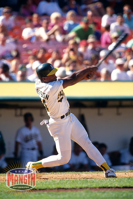 OAKLAND, CA - Oakland Athletics player Rickey Henderson in action batting at the Oakland Coliseum in Oakland, CA in 1990. Photo by Brad Mangin