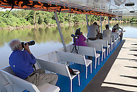Photographers shoot from our boat during the Tarcoles River cruise.
