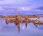 USA, California, Sierra Nevada Mountains.   Full Moon over Tufa Formations, Mono Lake
