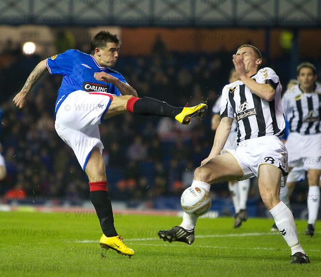 David Barron hurls his way in front of Nacho Novo's shot