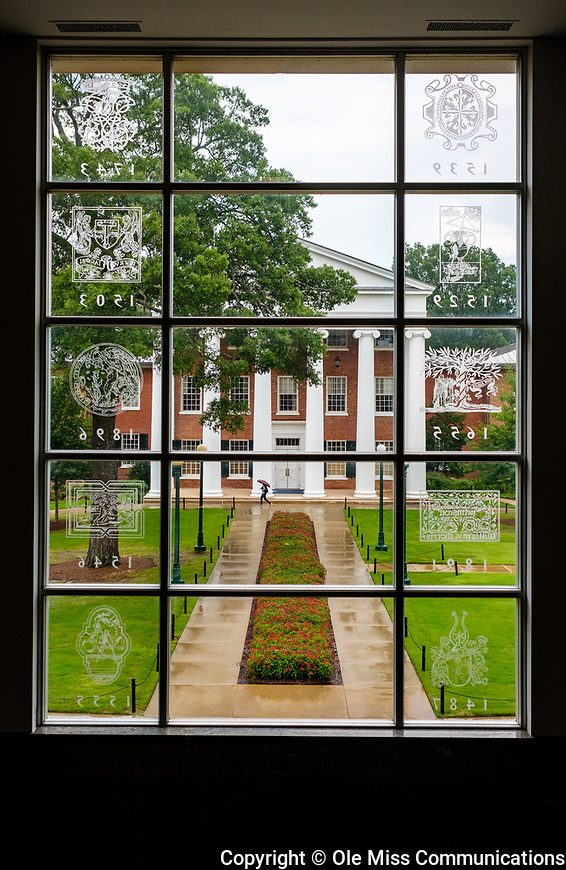 The Lyceum as seen from the etched glass window of the J. D. Williams Library on a rainy afternoon. Photo by Robert Jordan/Ole Miss Communications