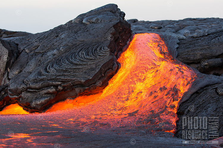 Lava Slab: A huge rock slides along a lava flow pouring out from a hot crack, 61g flow field, Hawai'i Volcanoes National Park, Big Island.