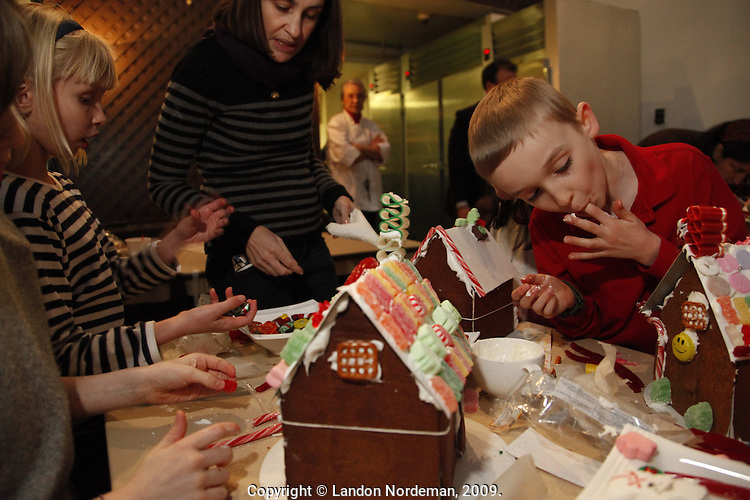 NEW YORK - DEC 5: Kids and their parents build gingerbread houses at The James Beard Foundation on Saturday, December 5, 2009 in New York City. (Photo by Landon Nordeman)