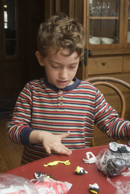 Berkeley CA Boy, five, modeling objects with soft clay at home  MR