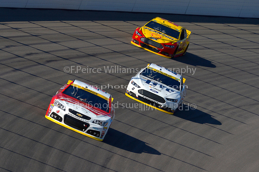 Kevin Harvick (#4), Brad Keselowski (#2) and Joey Logano (#22)