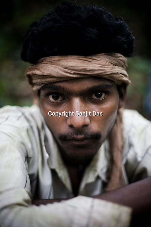 Romesh Takry poses for a portrait in the jungles around Salpojola village in Niyamgiri hills. He is one of the many people who will get displaced if the aluminium company Vedanta carries on with its plans of mining of Bauxide in Niyamgiri hills in Rayagara district of Orissa in India.