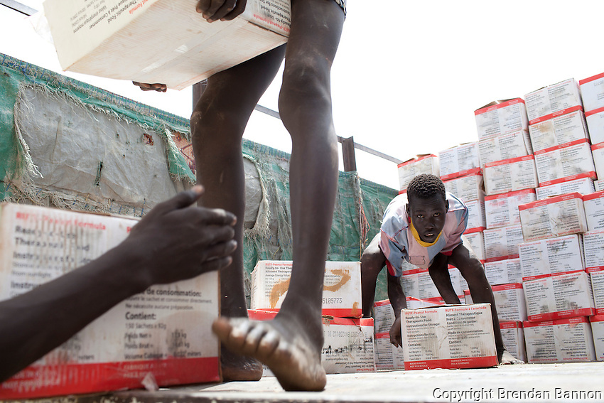 Families gather at a government Ministry of Health facility in Nasir, South Sudan for a distribution of Plumpy Nut. ust before the rains the hunger gap is at its worst in South Sudan. Rates of  malnutrition increase due to shortages of food stock and  insecurity.