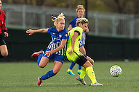 Allston, MA - Sunday, April 24, 2016: Boston Breakers player McCall Zerboni (77) and Seattle Reign FC midfielder Jessica Fishlock (10). The Boston Breakers play Seattle Reign during a regular season NSWL match at Harvard University.