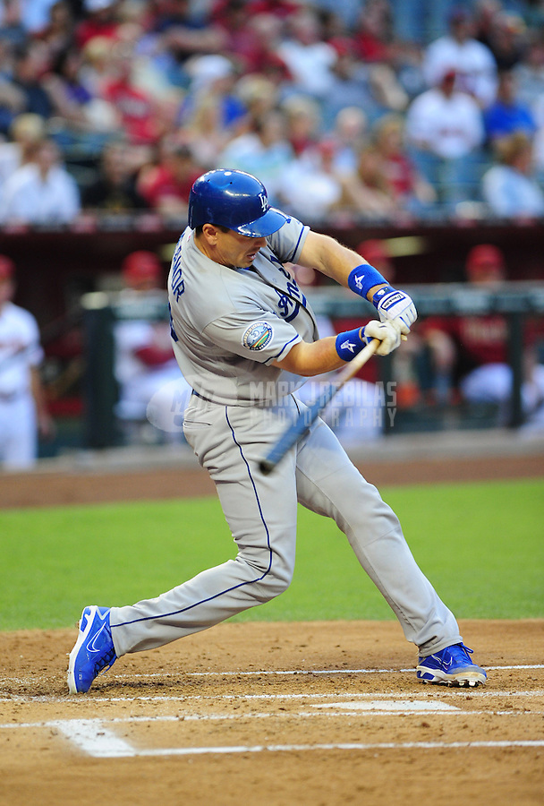 May 21, 2012; Phoenix, AZ, USA; Los Angeles Dodgers catcher Matt Treanor hits a two run home run in the second inning against the Los Angeles Dodgers at Chase Field.  Mandatory Credit: Mark J. Rebilas-