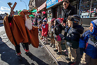 NEW YORK - JANUARY 06: A reveler greets the children  during Three Kings Day Parade in East Harlem January 6, 2017 in New York City. The parade celebrates the Feast of the Epiphany, also known as Three Kings Day, marking the Biblical story of the visit of three kings to Bethlehem to visit the baby Jesus, revealing his divinity. Photo by VIEWpress/Maite H. Mateo