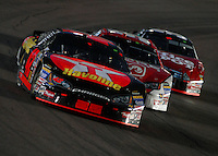 Apr 22, 2006; Phoenix, AZ, USA; Nascar Nextel Cup driver Casey Mears of the (42) Texaco Havoline Dodge Charger leads Kasey Kahne and Carl Edwards during the Subway Fresh 500 at Phoenix International Raceway. Mandatory Credit: Mark J. Rebilas-US PRESSWIRE Copyright © 2006 Mark J. Rebilas..
