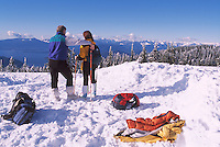 Couple hiking in Snow in Mount Seymour Provincial Park, in the Coast Mountains, North Vancouver, British Columbia, Canada