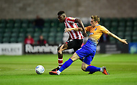 Lincoln City's Bernard Mensah vies for possession with Mansfield Town's Timi Elsnik<br /> <br /> Photographer Chris Vaughan/CameraSport<br /> <br /> The EFL Checkatrade Trophy Group H - Lincoln City v Mansfield Town - Tuesday September 4th 2018 - Sincil Bank - Lincoln<br />  <br /> World Copyright © 2018 CameraSport. All rights reserved. 43 Linden Ave. Countesthorpe. Leicester. England. LE8 5PG - Tel: +44 (0) 116 277 4147 - admin@camerasport.com - www.camerasport.com