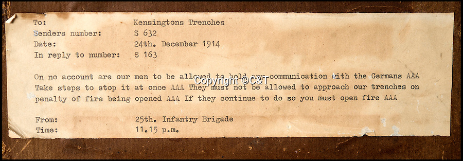 BNPS.co.uk (01202 558833)<br /> Pic: C&amp;T/BNPS<br /> <br /> Transcript on the back of the frame.<br /> <br /> An unseen order that reveals the British High Commands alarm as the famous Xmas truce of 1914 developed has come to light after 102 years.<br /> <br /> The order from the Brigade HQ of the County of London battalion the was rushed to the front line at 11.15pm on Christmas Eve 1914, as reports started filtering back of the fraternisation<br /> between the opposing trenches.<br /> <br /> The order commanded the officers in the trenches 'On no account are our men allowed to hold any communication with the Germans' and 'you must open fire'  if they approached the British lines.<br /> <br /> The festive-time ceasefire, in no-man's land near Flanders, is often cited as an inspiring symbol of peace in the midst of the otherwise bloody, violent conflict of the First World War.<br /> <br /> The framed order is being sold by C&amp;T Auctioneers, of Ashford in Kent, with an estimate of &pound;1,500 on September 7.