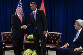United States President Barack Obama, center, attends a bilateral meeting with President Raul Castro, left, of Cuba as US Secretary of State John Kerry, far right, looks on at the United Nations Headquarters, New York, New York, on September 29, 2015. <br /> Credit: Anthony Behar / Pool via CNP