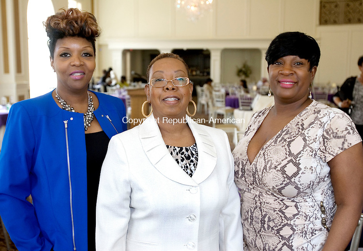 PROSPECT CT. 03 May 2014-050317SV13-From left, Pamela King of Waterbury, Pamela Jackson of Waterbury, and Michele Smith of Meriden attend The Greater Waterbury Chapter of the National Congress of Black Women, Inc. Scholarship Luncheon at Aria Wedding and Banquet Facility in Prospect Saturday. <br /> Steven Valenti Republican-American