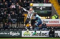 Michael O'Connor of Notts Co beats Adebayo Akinfenwa of Wycombe Wanderers in the air during the Sky Bet League 2 match between Notts County and Wycombe Wanderers at Meadow Lane, Nottingham, England on 10 December 2016. Photo by Andy Rowland.
