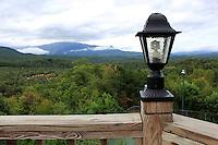 Stock photo: Lamp post on a wooden fence looking over smoky mountains hills and clouds in distance.