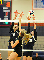 Central Bucks East's Julia Gallagher #3 and Krista Helveston #22 defend as William Tennent's Laura Cochrane #7 makes a shot during a District One first round volleyball match Tuesday October 27, 2015 in Buckingham, Pennsylvania. (Photo by William Thomas Cain)