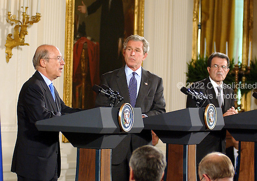 Prime Minister Constantine Simitis of Greece, President of the European Union (EU), left, makes remarks during a joint press conference with United States President George W. Bush, center, and European Commission Chairman Romano Prodi, right, in the East Room at the White House in Washington, DC on June 25, 2003..Credit: Ron Sachs / CNP