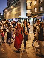 The Sarajevans walk along Marsala Tita avenue in Sarajevo.