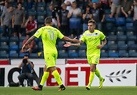 Sammie Szmodics of Colchester United celebrates with Ben Dickenson of Colchester United after scoring his goal during the Sky Bet League 2 match between Wycombe Wanderers and Colchester United at Adams Park, High Wycombe, England on 27 August 2016. Photo by Liam McAvoy.