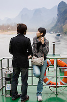 Tourists travel by boat along Li River between Guilin and Yangshuo, China