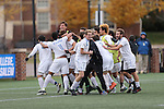 SALEM, VA - DECEMBER 3: Tufts players and coaches celebrate the winning goal in overtime of theDivision III Men's Soccer Championship held at Kerr Stadium on December 3, 2016 in Salem, Virginia. Tufts defeated Calvin 1-0 for the national title. (Photo by Kelsey Grant/NCAA Photos)