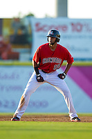 Nomar Mazara (12) of the Hickory Crawdads takes his lead off of second base against the Kannapolis Intimidators at L.P. Frans Stadium on May 25, 2013 in Hickory, North Carolina.  The Crawdads defeated the Intimidators 14-3.  (Brian Westerholt/Four Seam Images)