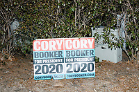 Campaign signs are seen in the yard as Democratic presidential candidate Senator Cory Booker (D-NJ) speaks at a house party at the home of State Senator Shannon Chandley and Tom Silva in Amherst, New Hampshire, USA, on Sat., Apr. 6, 2019.