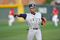 Shortstop Milton Ramos (7) of the Columbia Fireflies warms up before a game against the Greenville Drive on Friday, April 22, 2016, at Fluor Field at the West End in Greenville, South Carolina. Columbia won, 5-3. (Tom Priddy/Four Seam Images)
