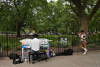 "New York, NY -  22 June 2010- A man plays a a piano in Tompkins Square Park in the East Village... ""Play Me I'm Yours"" is a musical installation by British artist Luke Jerram who has been touring the project globally since 2008. From 9am-10pm each day, 60 pianos will be available to play across New York City. Presented by Sing for Hope they are located in public parks, streets and plazas the pianos will be available until 5th July for any member of the public to play and engage with."