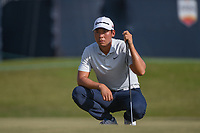 Xinjun Zhang (CHN) lines up his putt on 18 during round 4 of the 2019 Houston Open, Golf Club of Houston, Houston, Texas, USA. 10/13/2019.<br /> Picture Ken Murray / Golffile.ie<br /> <br /> All photo usage must carry mandatory copyright credit (© Golffile | Ken Murray)