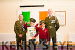 Sergeant Chris Hoare,  and Gunner James Power, with l-r  Twins Maria and Anna Draghici both in fourth class at the presentation of the   tricolour and Proclamation at Holy Family School Tralee to commemorate the 100 year anniversary on Monday
