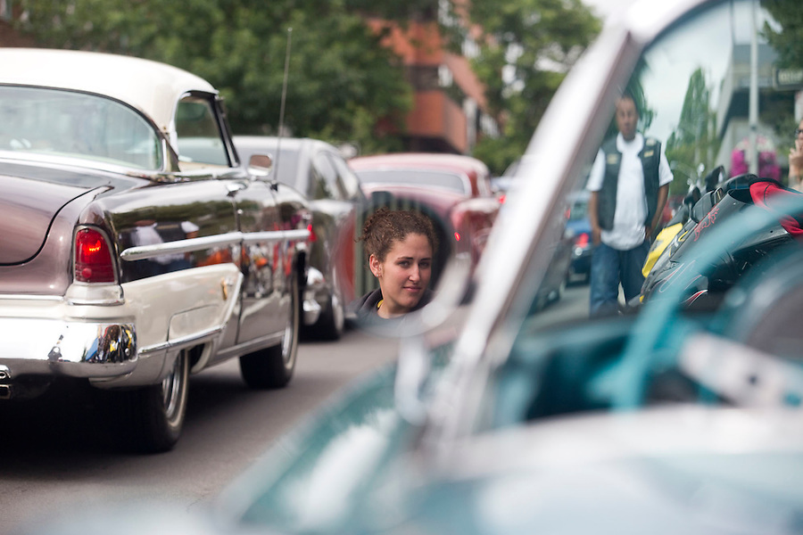 """Makila Schuck looks at vintage cars on Main Street in downtown Vancouver Saturday July 16, 2016. """"Cruisin' the Gut""""  is an annual event in which antique car enthusiasts drive up and down main street,. (Photo by Natalie Behring/ for the The Columbian)"""