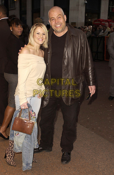 "CLIFF PARISI & GUEST.""Rollin' With The Nines"" - UK premiere at the Odeon Leicester Square, London, UK..April 19th, 2006.Ref: CAN.full length brown leather jacket pink off the shoulder top arm over shoulder.www.capitalpictures.com.sales@capitalpictures.com.©Capital Pictures"
