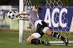 07 November 2008: Virginia Tech goalkeeper Kristin Carden makes the second of four saves in the penalty kick shootout. The University of Virginia and Virginia Tech played to a 1-1 tie after 2 overtimes at WakeMed Stadium at WakeMed Soccer Park in Cary, NC in a women's ACC tournament semifinal game.  Virginia Tech advanced to the final on penalty kicks, 2-1.
