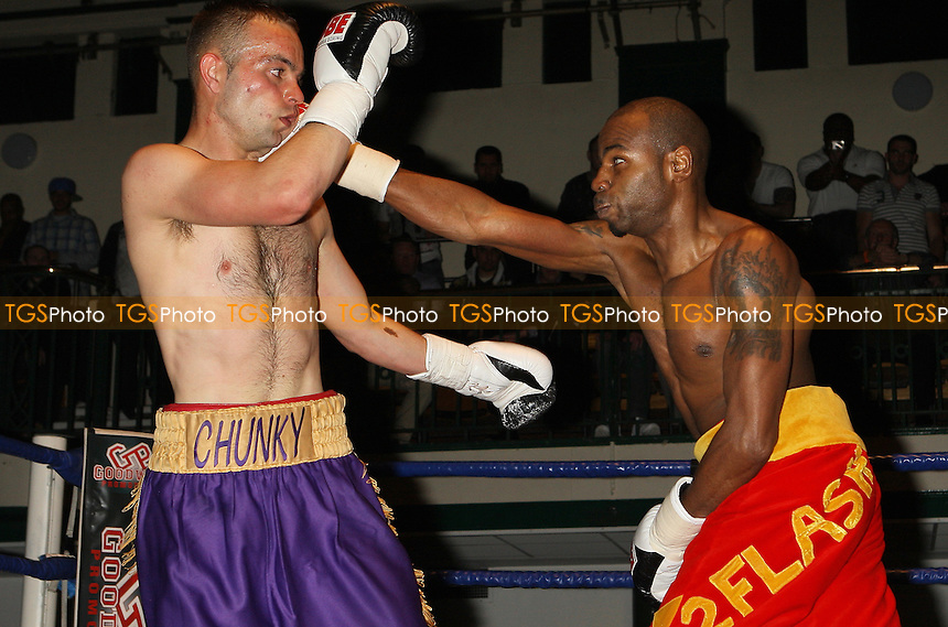 Mark Alexander (red shorts) defeats Michael Devine in a Lightweight boxing contest at York Hall, Bethnal Green, promoted by Steve Goodwin - 24/04/10 - MANDATORY CREDIT: Gavin Ellis/TGSPHOTO - Self billing applies where appropriate - Tel: 0845 094 6026