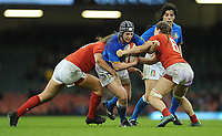 Italy&rsquo;s Lucia Gai is tackled by Wales Alisha Butchers <br /> <br /> Photographer Ian Cook/CameraSport<br /> <br /> 2018 Women's Six Nations Championships Round 4 - Wales Women v Italy Women - Sunday 11th March 2018 - Principality Stadium - Cardiff<br /> <br /> World Copyright &copy; 2018 CameraSport. All rights reserved. 43 Linden Ave. Countesthorpe. Leicester. England. LE8 5PG - Tel: +44 (0) 116 277 4147 - admin@camerasport.com - www.camerasport.com