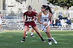 Los Angeles, CA 02/08/13 - Kara Mupo  (Northwestern #8) and Tanner Guarino  (Umass #15) in action during the Northwestern vs UMass NCAA Women's Lacrosse game at USC's McAlister Field.