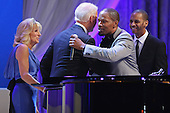 United States Vice President Joe Biden (2nd L) and Dr. Jill Biden (L) embrace actor and musician Jamie Foxx after he sang while they danced at the Inaugural Ball at the Walter Washington Convention Center January 21, 2013 in Washington, DC. Biden and President Barack Obama started their second term by taking the Oath of Office earlier in the day during a ceremony on the West Front of the U.S. Capitol. .Credit: Chip Somodevilla / Pool via CNP