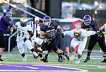 SIOUX FALLS, SD, OCTOBER 8:  Max Mickey #22 from the University of Sioux Falls scampers past Tyler Flud #27 and Drew Fellenz #96 from Southwest Minnesota State University in the first half Saturday night at Bob Young Field. (Photo by Dave Eggen/Inertia)