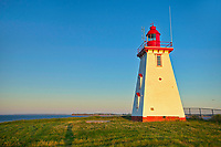 Souris East Lighthouse (historic)  above the cliff on Knight Point. sunrise<br />