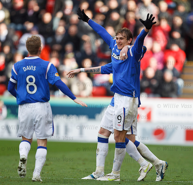Nikica Jelavic celebrates after scoring from the penalty spot and putting Rangers 2-0 up