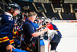 Stockholm 2014-08-21 Ishockey CHL Djurg&aring;rdens IF - Fribourg-Gotteron  :  <br /> Djurg&aring;rdens m&aring;lvakt Mikael Tellqvist har problem med benskydden utrustningen och f&aring;r hj&auml;lp av Djurg&aring;rdens materialf&ouml;rvaltare vid b&aring;set under matchen<br /> (Foto: Kenta J&ouml;nsson) Nyckelord:  Djurg&aring;rden Hockey Hovet CHL Fribourg Gotteron