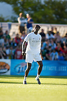 Manchester City forward Emmanuel Adebayor warms up before a match at Merlo Field in Portland Oregon on July 17, 2010.